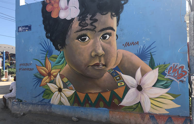 Holbox street art features a young girl.