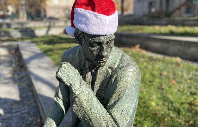 Christmas in Washington DC is a Santa hat on a statue.